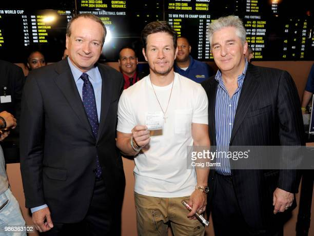 William Hill US CEO Joe Asher Mark Wahlberg and Bruce Deifik of Ocean Resort Casino attend William Hill Sports Book Opening on June 28 2018 in...