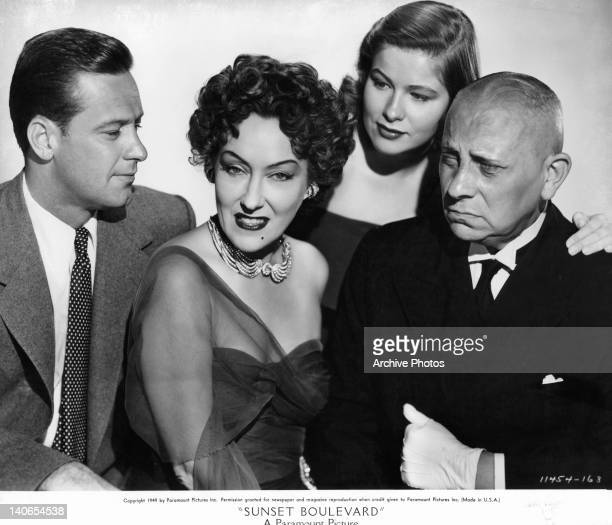 William Holden and Gloria Swanson pose with others in a scene from the film 'Sunset Boulevard' 1950