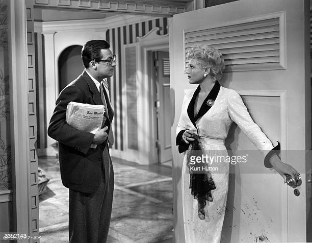 William Holden and Judy Holliday star in the Columbia picture 'Born Yesterday' for which she received an Academy Award The film is adapted from an...