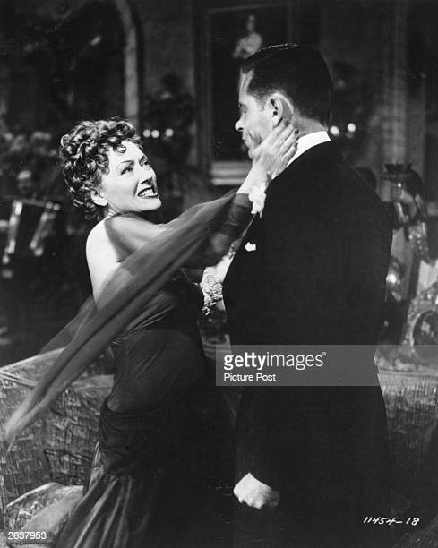 William Holden gets a slap from Gloria Swanson in a scene from 'Sunset Blvd' the story of a luckless Hollywood scriptwriter who becomes the focus of...