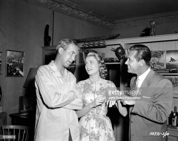 William Holden points out Grace Kelly's engagement ring to James Stewart in a moment of fun on the set of Hitchcock's 'Rear Window'