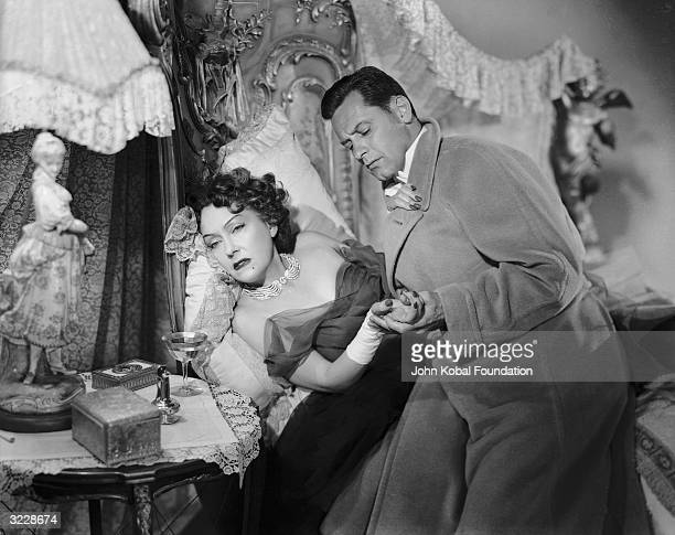 William Holden returns to find that Gloria Swanson has tried to slash her wrists in 'Sunset Boulevard', directed by Billy Wilder.