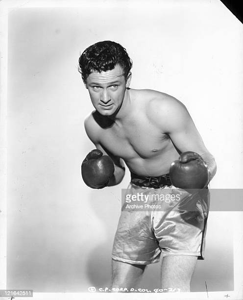 William Holden with boxing gloves on in a scene from the film 'Golden Boy' 1939