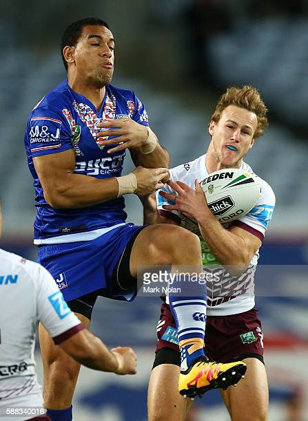 William Hopoate of the Bulldogs and Daly CherryEvans of the Eagles contest a high ball during the round 23 NRL match between the Canterbury Bulldogs...
