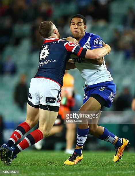 William Hopoate of the Bulldogs is tackled during the round 17 NRL match between the Sydney Roosters and the Canterbury Bulldogs at Allianz Stadium...