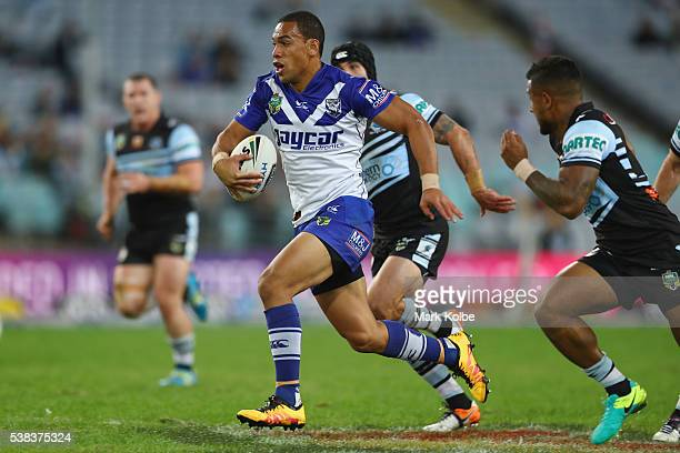 William Hopoate of the Bulldogs makes a break during the round 13 NRL match between the Canterbury Bulldogs and the Cronulla Sharks at ANZ Stadium on...