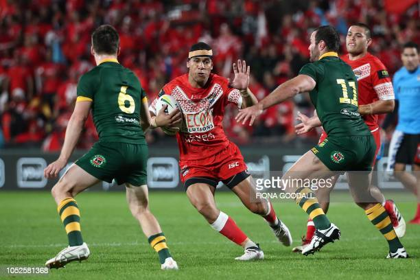 William Hopoate of Tonga looks for a gap during the rugby league international Test match between Australia and Tonga at Mt Smart Stadium in Auckland...