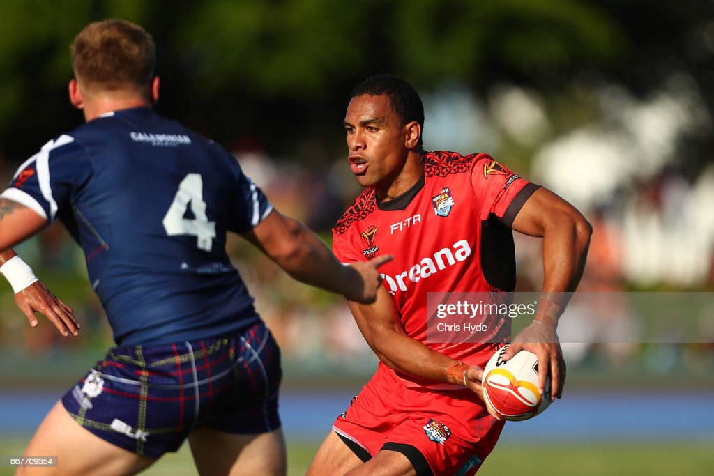 William Hopoate of Tonga passes during the 2017 Rugby League World Cup match between Scotland and Tonga at Barlow Park on October 29, 2017 in Cairns, Australia.