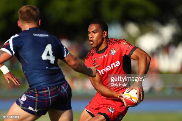 William Hopoate of Tonga passes during the 2017 Rugby League World Cup match between Scotland and Tonga at Barlow Park on October 29 2017 in Cairns...