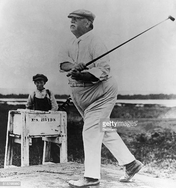 William Howard Taft plays golf A caddy stands beside a box marked NO 8 215 YD'S Undated photograph