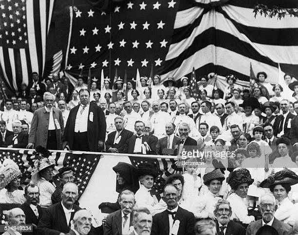 William Howard Taft stands on a platform addressing a crowd during a campaign rally for his Republican presidential candidacy Undated photograph...
