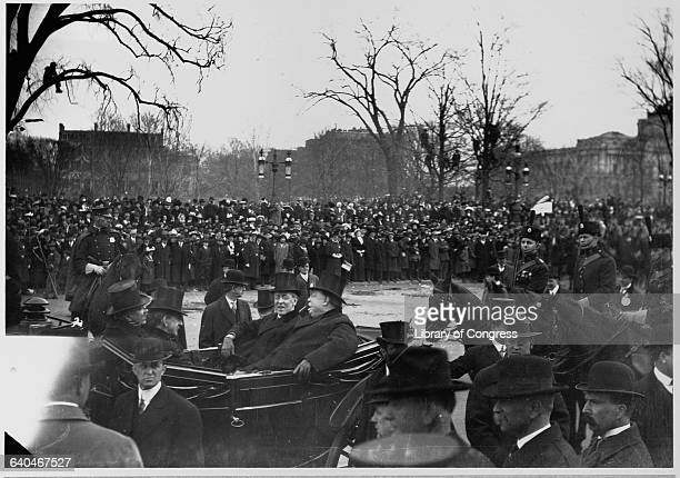 William Howard Taft, the 27th President of the United States, rides in a carriage with Woodrow Wilson during the inauguration of Wilson in 1913.