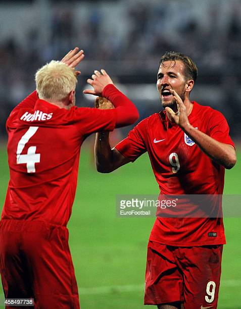 William Hughes of England celebrate with his teammate Harry Kane after scoring a goal during the UEFA U21 Championship Playoff Second Leg match...