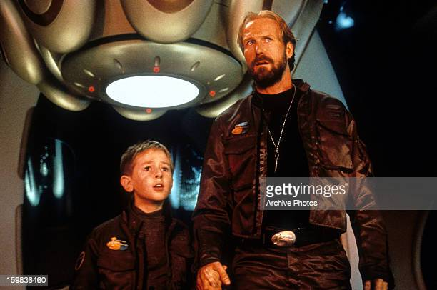 William Hurt standing next to a child in a scene from the film 'Lost In Space' 1998