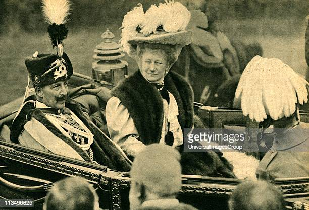 William II Emperor of Germany from 18881919 in the uniform of the Totenkopf Hussars riding in an open carriage with his consort Empress Augusta...
