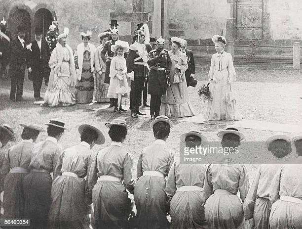 William II Emperor of Germany with his wife on a visit at the finishing school in the foreground girls dropping a curtsy Photography 1910 [Der...