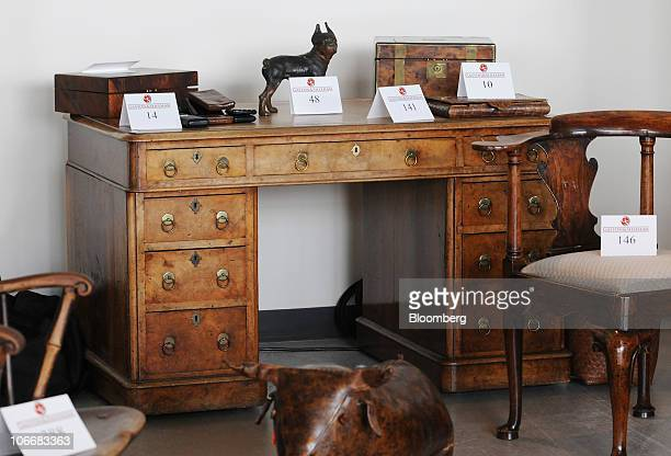 A William IV mahogany and burl elm desk is displayed with other items during a media preview of the auction of personal property that once belonged...
