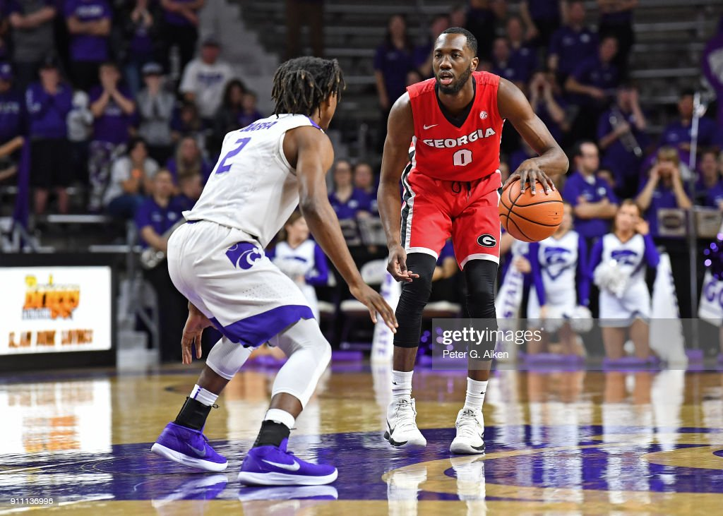 William Jackson II #0 of the Georgia Bulldogs brings the ball up court against Cartier Diarra #2 of the Kansas State Wildcats during the first half on January 27, 2018 at Bramlage Coliseum in Manhattan, Kansas.