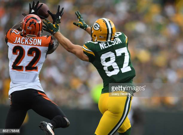 William Jackson of the Cincinnati Bengals intercepts a pass from Aaron Rodgers to Jordy Nelson of the Green Bay Packers at Lambeau Field on September...