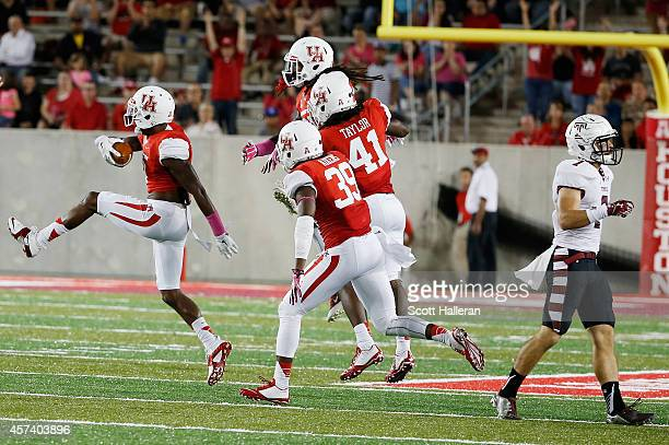 William Jackson of the Houston Cougars celebrates his interception against the Temple Owls in the first half of their game at TDECU Stadium on...