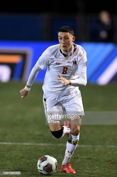 William James Herve of the Maryland Terrapins brings the ball up the field against the Akron Zips during the Division I Men's Soccer Championship...