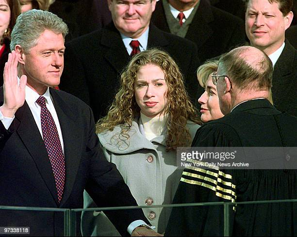 William Jefferson Clinton is sworn in during the 53rd Presidential Inauguration on the steps of the Capitol in Washington Supreme Court Chief Justice...