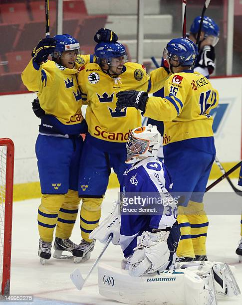William Karlson Mika Zibanejad and Flip Forsberg of Team Sweden celebrate a goal at 621 of the third period against Janne Juvonen of Team Finland at...