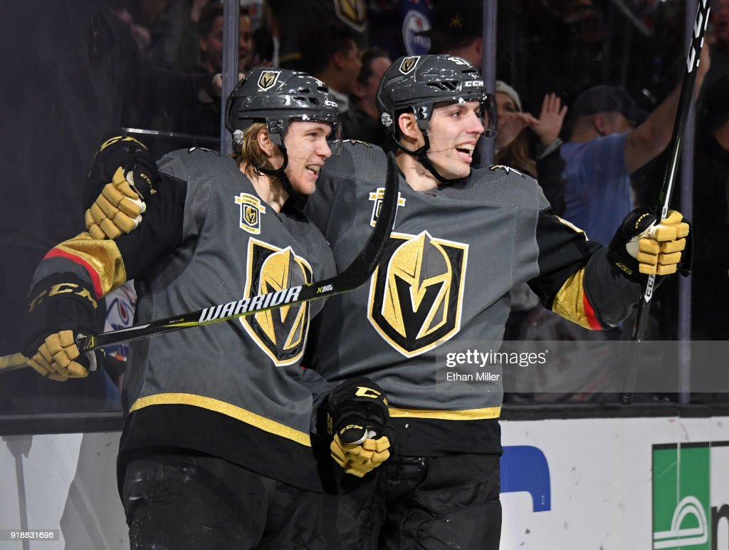 William Karlsson (L) #71 and David Perron #57 of the Vegas Golden Knights celebrate after Perron assisted Karlsson on a second-period power-play goal against the Edmonton Oilers during their game at T-Mobile Arena on February 15, 2018 in Las Vegas, Nevada.