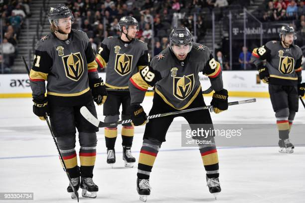 William Karlsson and Alex Tuch of the Vegas Golden Knights wait for play to resume during the game against the New Jersey Devils at TMobile Arena on...