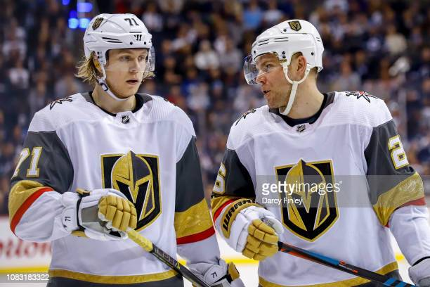 William Karlsson and Paul Stastny of the Vegas Golden Knights discuss strategy during a third period stoppage in play against the Winnipeg Jets at...