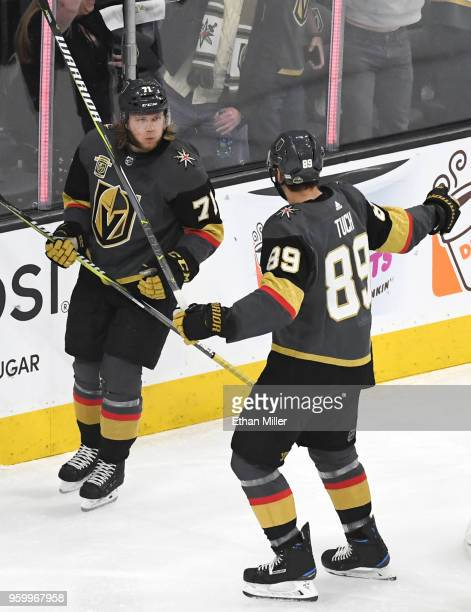 William Karlsson is congratulated by his teammate Alex Tuch of the Vegas Golden Knights after scoring a firstperiod goal against the Winnipeg Jets in...