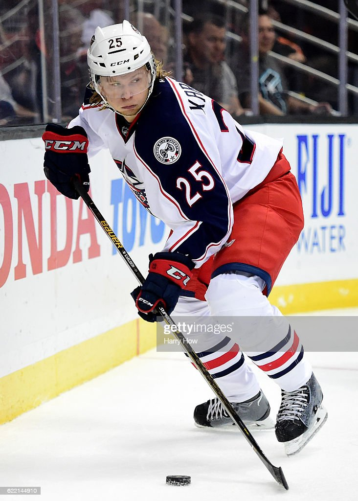 William Karlsson #25 of the Columbus Blue Jackets looks back as he controls the puck along the boards during the game against the Anaheim Ducks at Honda Center on October 28, 2016 in Anaheim, California.