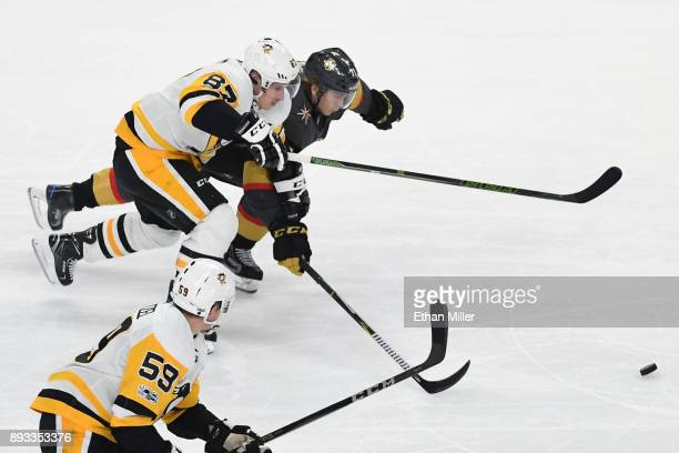 William Karlsson of the Vegas Golden Knights and Sidney Crosby of the Pittsburgh Penguins chase the puck in the third period of their game at TMobile...