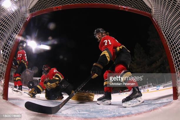 William Karlsson of the Vegas Golden Knights attempts to clear the puck behind goaltender Marc-Andre Fleury during the second period of the 'NHL...