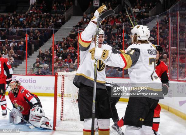 William Karlsson of the Vegas Golden Knights celebrates his third period goal against the Ottawa Senators with teammate Reilly Smith as Craig...