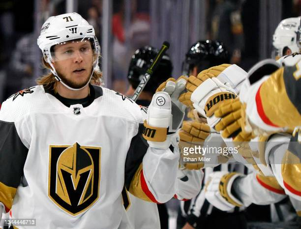 William Karlsson of the Vegas Golden Knights celebrates with teammates on the bench after scoring a third-period goal against the Los Angeles Kings...