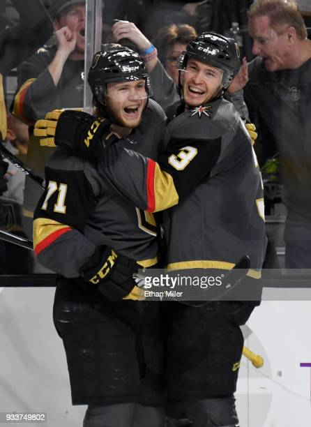 William Karlsson of the Vegas Golden Knights celebrates with teammate Brayden McNabb after Karlsson scored his third goal of the second period...