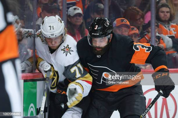 William Karlsson of the Vegas Golden Knights gets checked into the boards by Radko Gudas of the Philadelphia Flyers at the Wells Fargo Center on...