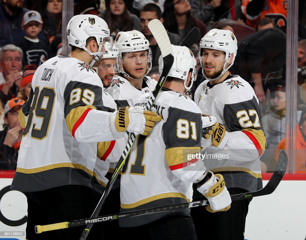 William Karlsson #71 of the Vegas Golden Knights is congratulated by teammates Alex Tuch #89,Jonathan Marchessault #81 and Shea Theodore #27 of the Vegas Golden Knights in the third period against the Philadelphia Flyers on March 12, 2018 at Wells Fargo Center in Philadelphia, Pennsylvania.