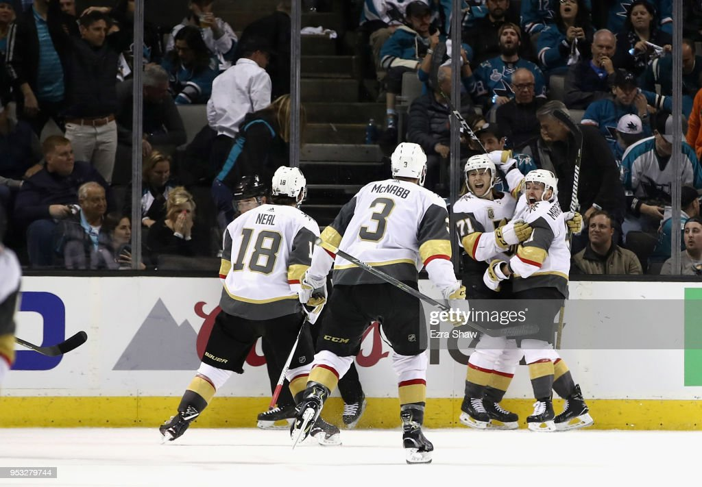 William Karlsson #71 of the Vegas Golden Knights is congratulated by Jonathan Marchessault #81, James Neal #18, and Brayden McNabb #3 of the Vegas Golden Knights after he scored the winning goal in overtime against the San Jose Sharks during Game Three of the Western Conference Second Round during the 2018 NHL Stanley Cup Playoffs at SAP Center on April 30, 2018 in San Jose, California.