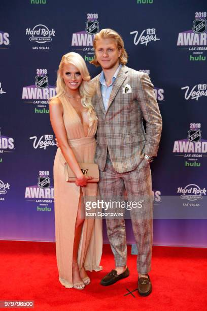 William Karlsson of the Vegas Golden Knights poses for photos on the red carpet with his girlfriend Emily Ferguson during the 2018 NHL Awards...