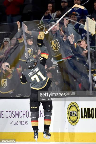 William Karlsson of the Vegas Golden Knights tosses his stick to a fan after the Golden Knights defeated the Vancouver Canucks 63 at TMobile Arena on...