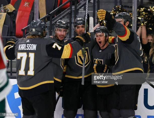 William Karlsson, Reilly Smith, Alec Martinez, Jonathan Marchessault and Alex Pietrangelo of the Vegas Golden Knights celebrate Marchessault's...