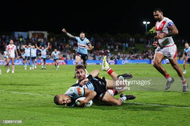 William Kennedy of the Sharks scores a try during the round one NRL match between the St George Illawarra Dragons and the Cronulla Sharks at...