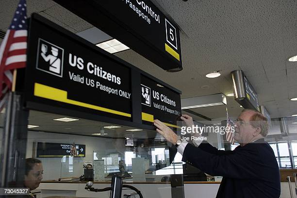 William Kuiken from the MiamiDade Aviation department changes a sign at the US Customs and Border Protection Passport control area January 19 2007 at...