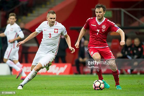 William Kvist of Denmark and Artur Jedrzejczyk of Poland during the FIFA World Cup 2018 Qualifying Group E match between Poland and Denmark at PGE...