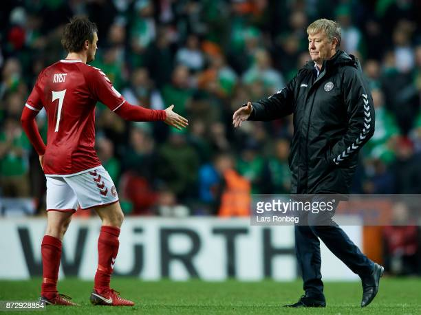 William Kvist of Denmark shake hands with Age Hareide head coach of Denmark after the FIFA 2018 World Cup Qualifier PlayOff First Leg match between...