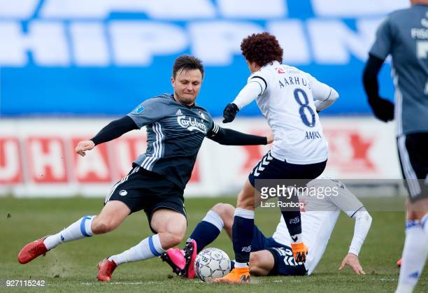 William Kvist of FC Copenhagen and Mustafa Amini of AGF Aarhus compete for the ball during the Danish Alka Superliga match between AGF Aarhus and FC...