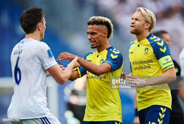 William Kvist of FC Copenhagen in discussion with Hany Mukhtar and Johan Larsson of Brondby IF during the Danish Alka Superliga match between Brondby...