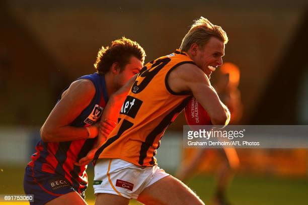 William Langford of Box Hill runs with the ball during the round seven VFL match between Port Melbourne and Box Hill at North Port Oval on June 3,...